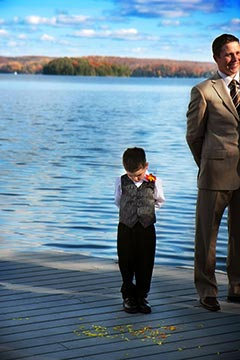 Northern Ontario Wedding Photography - Ringbearer near lake looking down