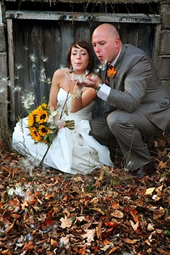 Nature Wedding Photography - Bride and Groom blowing wishes in the Fall