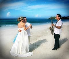 Destination Wedding Photo - Dancing on the beach with saxophone