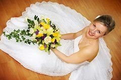 Beautiful Toronto Wedding Photography - Bride sitting on floor with bouquet